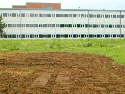 Ground where test pit is dug is covered with clean soil and normal use of the field can resume.