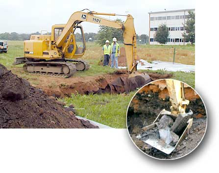 Hole is dug, excavated soil is placed on a plastic tarp and obljects and soil layers in the hole are observed.