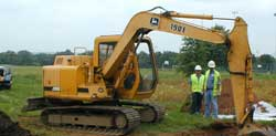 Backhoe removing fill